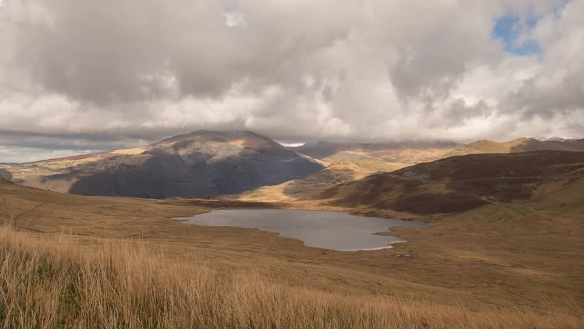 A time lapse view across Llyn Dwythwch to Elidir Fawr in the distance, Snowdonia National Park, Wales, UK.