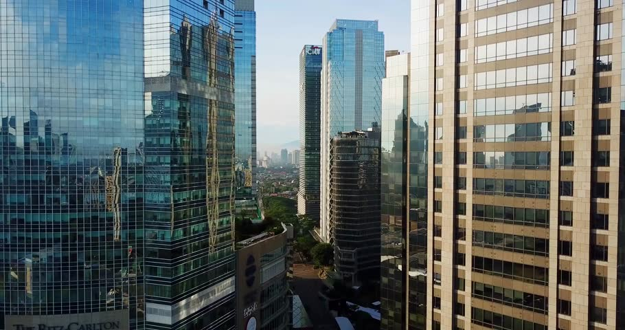 JAKARTA - Indonesia. March 19, 2018: Aerial landscape of modern skyscrapers with glass windows in Jakarta central business district from a drone. Shot in 4k resolution