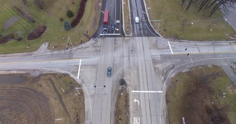 A view looking down at the 4-way intersection of Route 53 and Manhattan Road on a cloudy late winter day