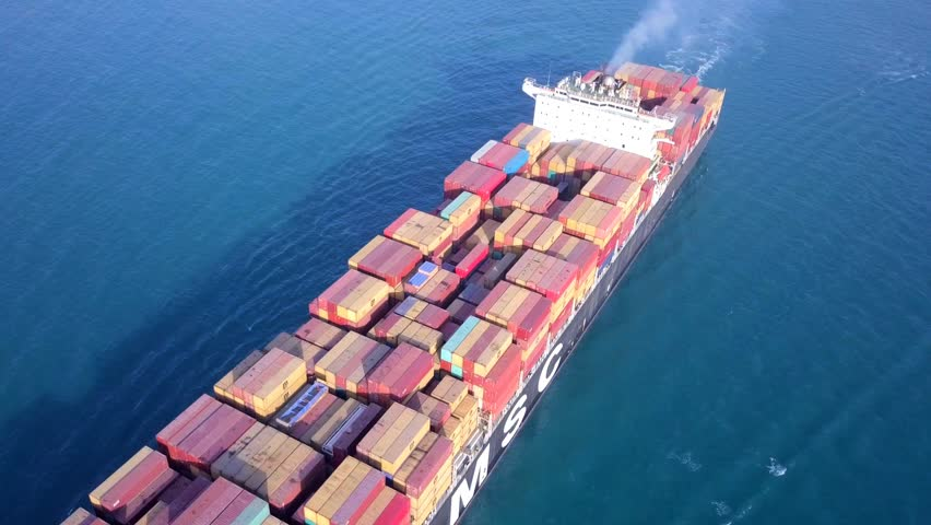 Mediterranean sea - March 28, 2018: Aerial footage of M.S.C Asya mega container ship at sea, loaded with various container brands  #1009242089