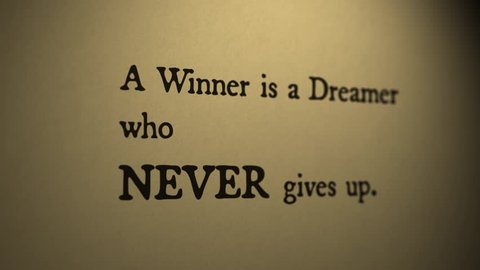 Motivational Quote 'Winner Is a Dreamer Who Never Gives Up'. Typewriter style, melancholic lighting. Perfect for your motivation related projects.