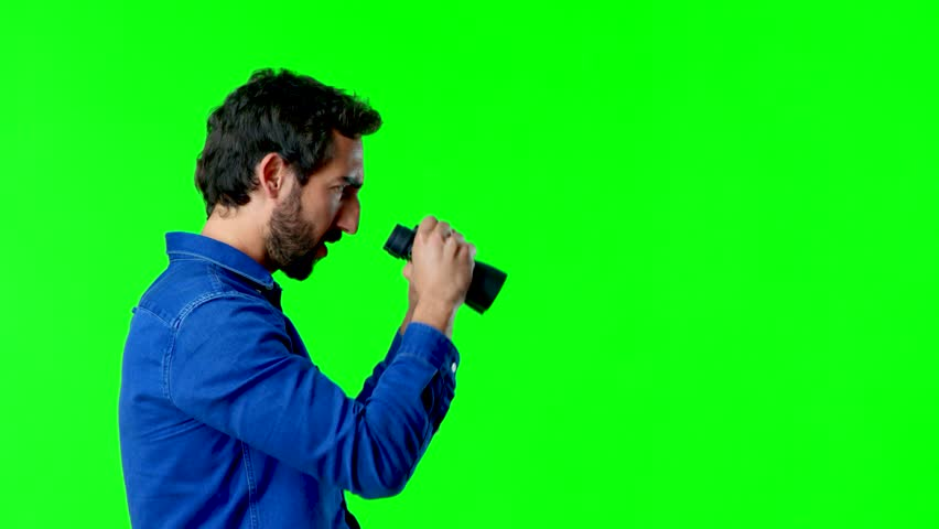 Young crazy man looking far with a binoculars | Shutterstock HD Video #1009283159