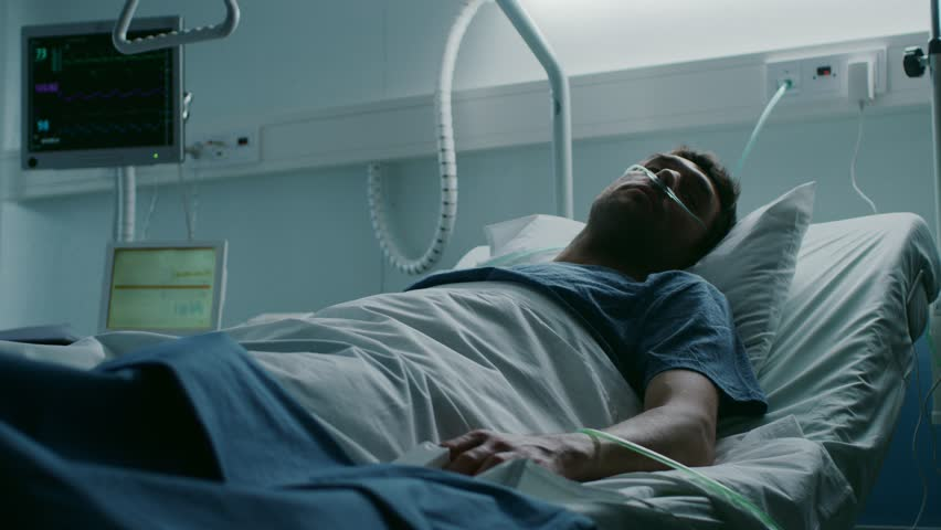 In the Hospital, Terminally Ill Man Suffers While Lying on the Bed. Young Man in Palliative Care Ward. Shot on RED EPIC-W 8K Helium Cinema Camera. | Shutterstock HD Video #1009295609