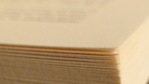 Extreme close-up of a book pages in turning action, book with turning pages