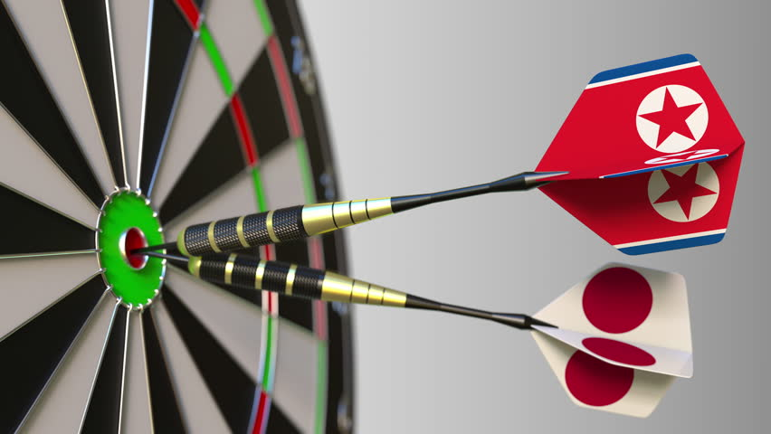 Flags of North Korea and Japan on darts hitting bullseye of the target. International cooperation or competition conceptual animation | Shutterstock HD Video #1009337309