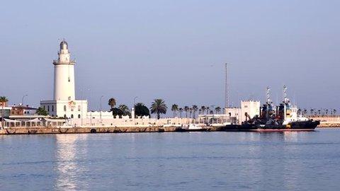 """Aug, 2017 - Malaga, SPAIN: Lighthouse """"La Farola de Malaga"""" in Malaga"""