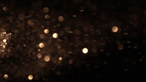 Golden glitter exploding, Phantom camera slow motion clip.