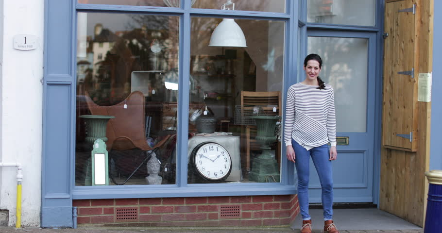 Portrait of small business owner outside store