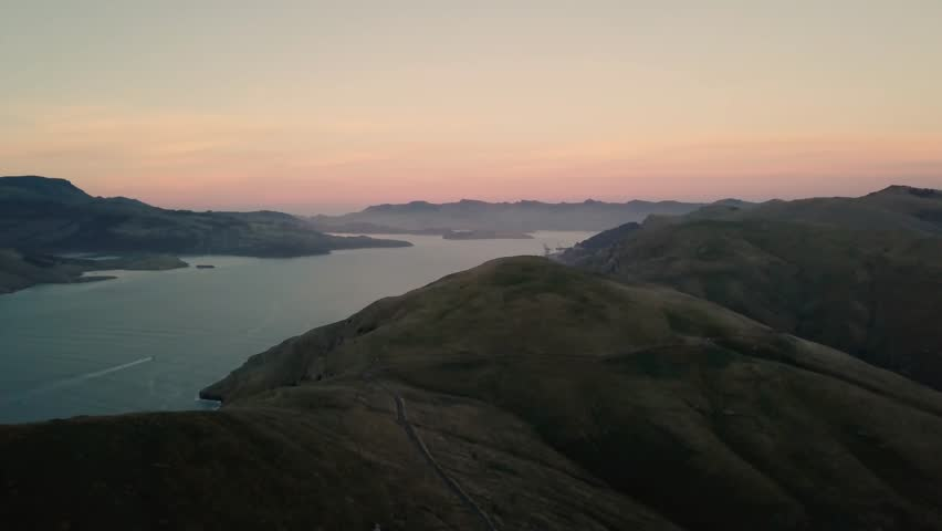 Coast of New Zealand shot by drone during sunrise or sunset in autumn season. Scenic and pristine nature | Shutterstock HD Video #1009448369