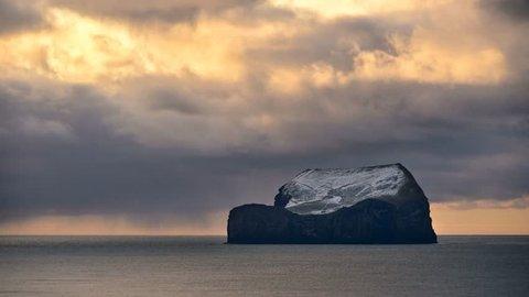 Alone island - stormy clouds ocean time lapse video in Westman Islands (Vestmannaeyjar -Iceland) 4k