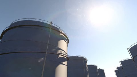 Fuel storage tanks, time lapse from dawn to dusk