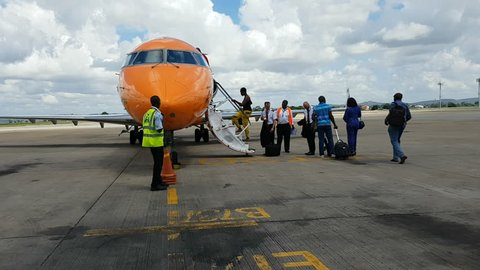 Mombasa, Kenya - march 24, 2018. People embarking on a small african jet plane at the airport of  Mombasa, in Kenya