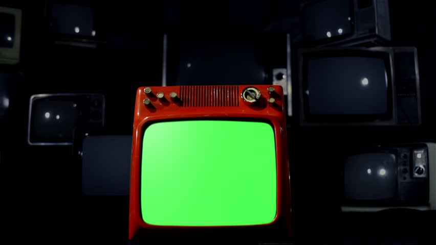 "Antique TV with Green Screen over a Black Bakground of Old TVs. Night Tone. Dolly In Shot. You can replace green screen with the footage or picture you want. You can do it with ""Keying"" FX. 