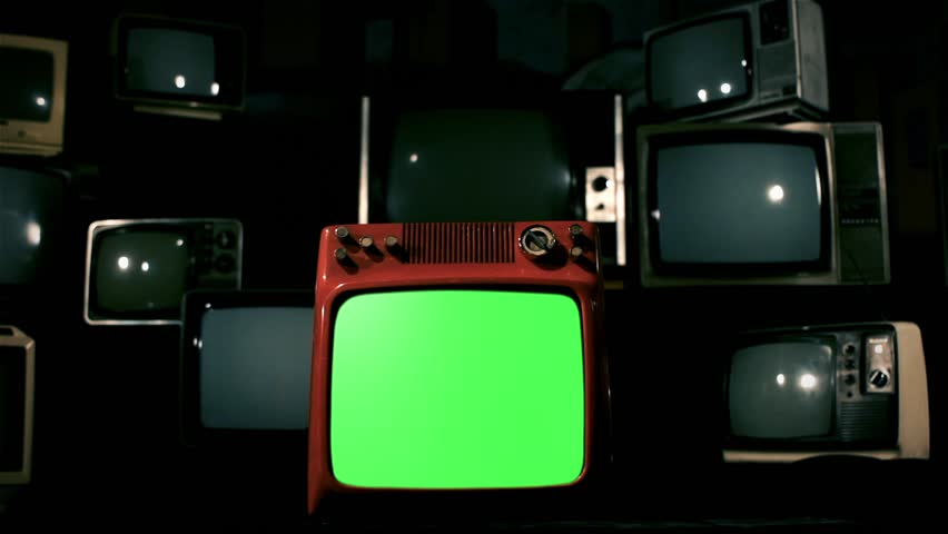 Old Red Tv Green Screen in the Middle of Many Tvs. Dolly Rolling Out Lighting Blue Steel Color Tone. | Shutterstock HD Video #1009488719