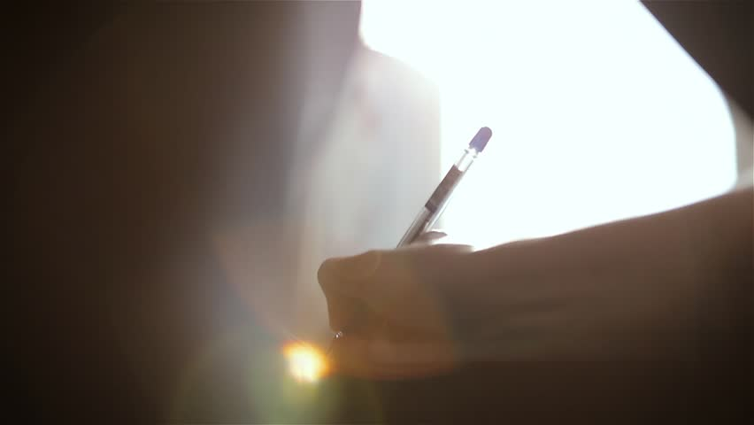 Close-up. A woman is writing a pen with a letter sitting at the table. | Shutterstock HD Video #1009493459