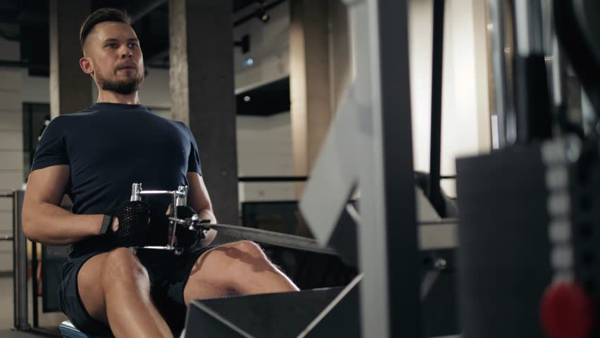 very power athletic guy bodybuilder, execute exercise with gym apparatus, indoor crossfit man boxer