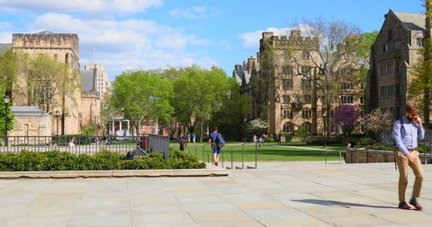 NEW HAVEN, CT MAY 03: Students walk around the outside of the Ivy League campus at Yale University on May 03, 2017 in New Haven, Ct.