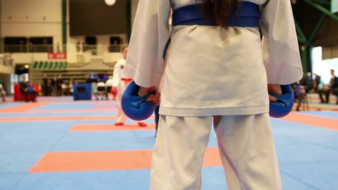 Sports teenagers - kid sportsmen at karate tatami - ready for fight