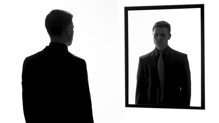 Man lighting cigarette, conscience voice asking quit smoking, mirror reflection