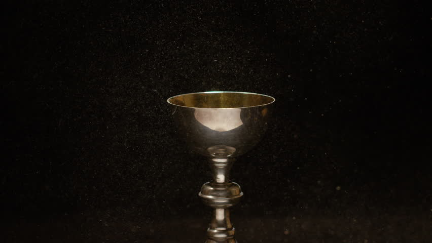 Catholic golden chalice with slow motion dust swirling