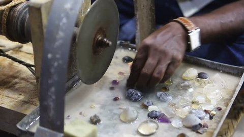Sri Lankan Jeweler polishing precious stones in the workshop. Handmade traditional jewel Manufacturing in Sri Lanka (Ceylon). Gems Manufacturing Process in Asia. Asian precious stones, Jewel and Gems