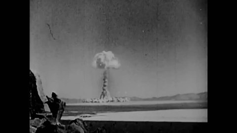CIRCA 1958 - Albert Einstein and various scientists are shown at work and an atomic bomb explodes into a mushroom cloud in a desert in New Mexico.
