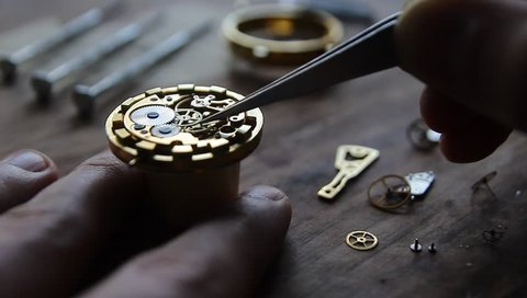 Watchmaler is repairing mechanical watches