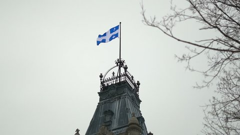 Provincial Flag of Quebec on Top of The Parliament Building in Slow Motion