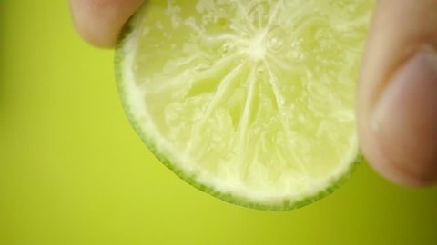 A lime squeezed in slow motion - Close-up