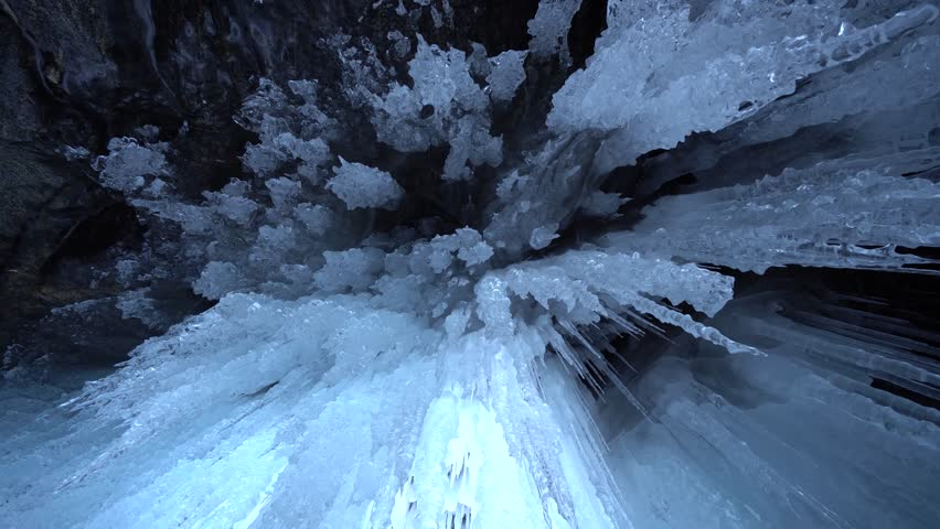 Crystals ice brilliant transparent Close glass acute cold untouched wild innocent. Cave hanging from ceiling inside. Unique winter frost cold season environment Travel. Dolly