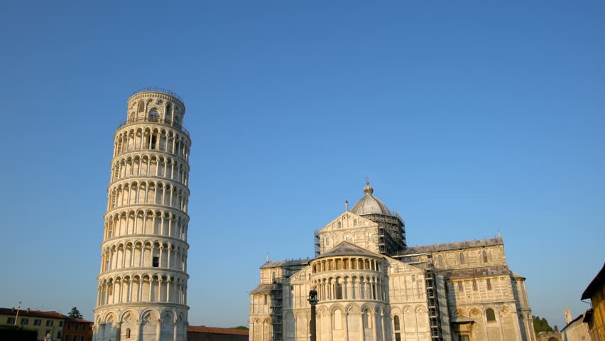Leaning Tower of Pisa in Pisa, Italy. Leaning Tower of Pisa known worldwide for its unintended tilt , travel destination of Italy. The bell tower is situated behind The Pisa Cathedral.   Shutterstock HD Video #1009688369