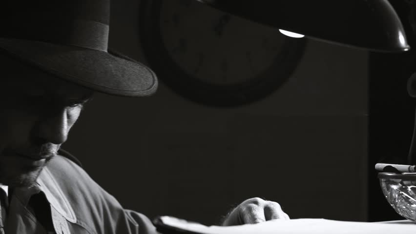 Noir film investigator searching top secret files in the office at night, retro noir film character