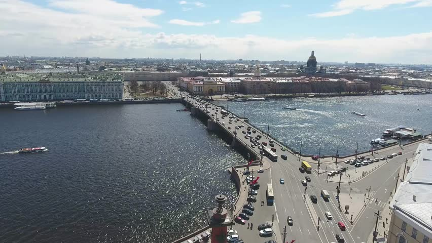 Aerial cinematic view of st. Petersburg city. Neva river panorama. Rostral Columns in St. Petersburg, Russia. Drone unique high altitude flight over city. Flight over St. Petersburg | Shutterstock HD Video #1009742099