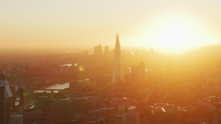 London UK - November 2017: Aerial view morning sunrise with sun flare over Canary Wharf River Thames The Shard London England United Kingdom RED WEAPON