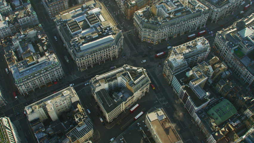 Aerial view at sunrise Oxford Circus buildings vehicle traffic and pedestrians City of Westminster London England UK RED WEAPON | Shutterstock HD Video #1009745819