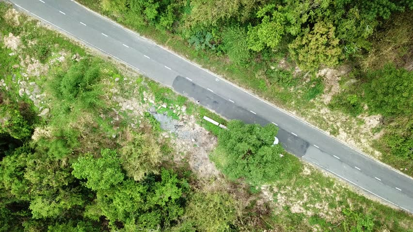 Top view. Aerial view from drone. Royalty high quality free stock image of road in forest. Road in forest is beautiful with many tree, road on pass very winding and curve