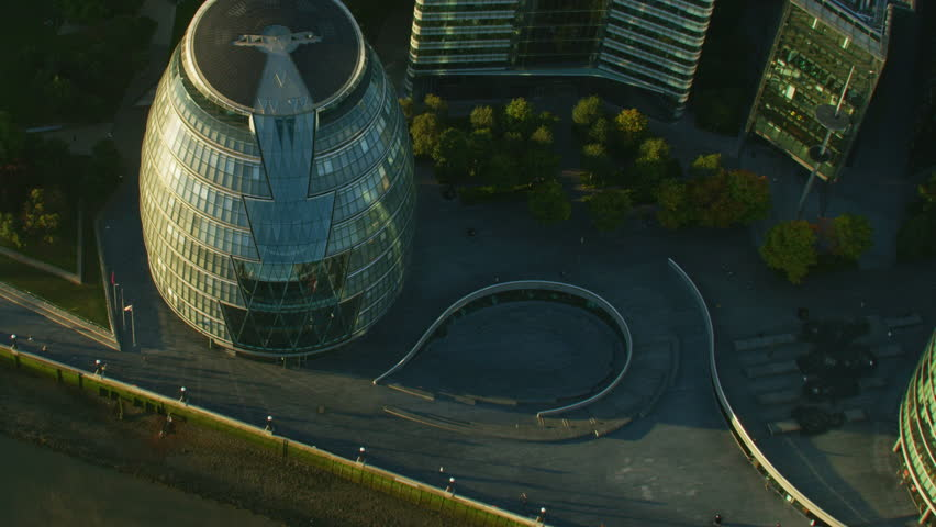 Aerial view at sunrise London City Hall glass bulbous building barge on River Thames Tower Bridge England UK RED WEAPON