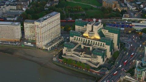 Aerial view at sunset SIS MI6 Building Vauxhall Cross commuter traffic Vauxhall Bridge River Thames London England UK