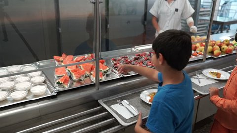 VIENNA AUSTRIA - CIRCA SEPTEMBER 2017: 2 boys at French high school getting food from from a school canteen