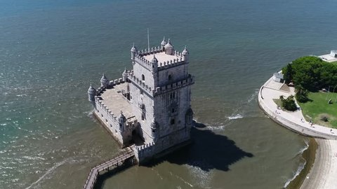 Aerial footage of Belem Tower in Portuguese Torre de Belem or the Tower of Saint Vincent is fortified tower located in the civil parish of Santa Maria de Belem in the municipality of Lisbon Portugal