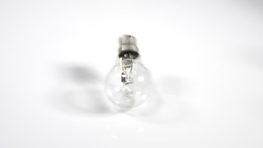 4K Light bulb rolling on white surface background, moving object, energy efficient, moving out of shot  | Shutterstock HD Video #1009845809
