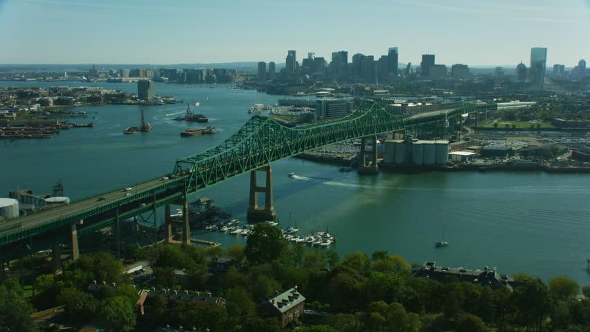 Boston, USA - November, 2017: Aerial view of Tobin Memorial 2 tier road vehicle bridge over the Mystic river city skyscrapers downtown Boston Massachusetts