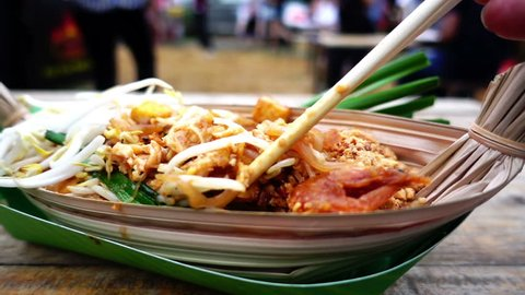 Pad Thai popular food in Bangkok, HD slow motion