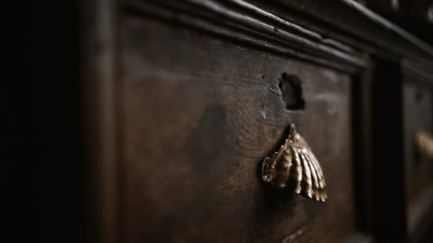 indoor farmer house , panorama on detail of vintage cupboard with handle in the form of a shall and old wooden texture