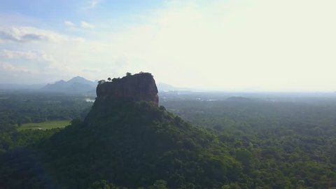 Aerial view of Sigiriya rock at misty morning Sri Lanka drone footage