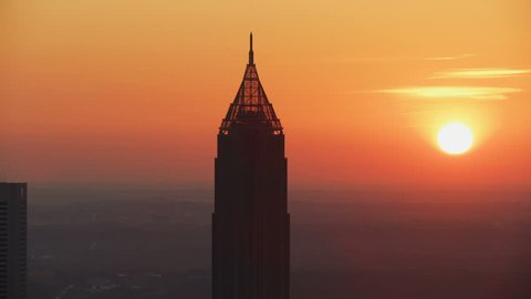 Dawn sunrise aerial view of the Bank of America Plaza and Art Deco style unique pinnacle spire at the top Atlanta city Georgia America