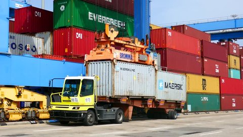 Haifa, Israel -  april 12, 2018 : Container carne lifts 20 feet container from terminal tractor