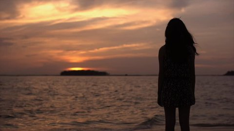 Cinemagraph Sad Girl viewing sunset in beach