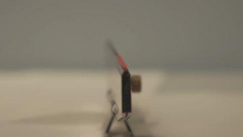 Man applying glue stick, frontal shot.