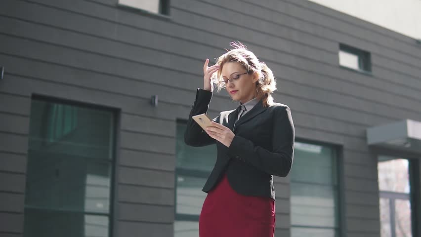 Portrait of business woman with mobile phone hands   Shutterstock HD Video #1009964459